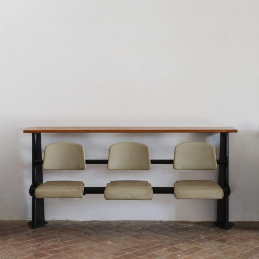 Lecture hall chairs in rows with lift-up seat by Jean Prouve